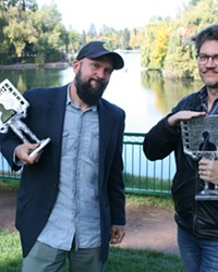 Festival Director Todd Looby and Festival Programmer Erik Jambor get silly with BendFilm's award statues during our interview in Bend's Drake Park.