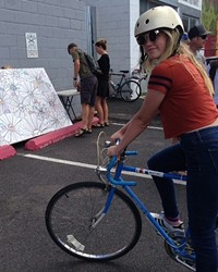 A local teen rolls into the Makers' Faire at the Bend Open Streets event last year.