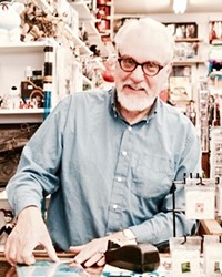 Duncan McGeary stands in his shop Pegasus Books in downtown Bend, Oregon.