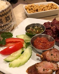 Tantilizing beef and pork sausage, with crispy peanuts, make for a delictable treat at Nam Tok Kitchen.