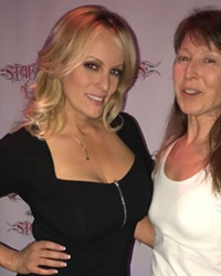 Reporter Cathy Carroll, right, asking Stormy Daniels questions at Stars Cabaret in Bend Thursday.
