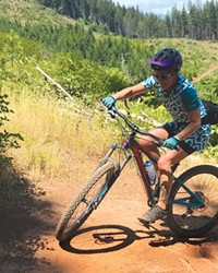 Emily Carr navigates a switchback in Post Canyon—in a cycling dress.