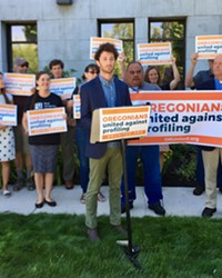 Noah Goldberg-Jaffe of the Oregon AFL-CIO speaks at the Deschutes County Courthouse on July 9.