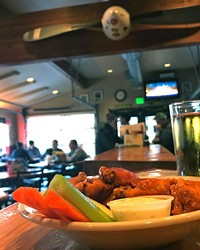 """Chicken wings on the brew house's """"Eat 4 Cheap!"""" menu"""