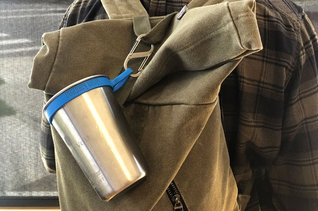 With the help of hardware that's easy to clip onto bags and purses, like this cup and clip from 