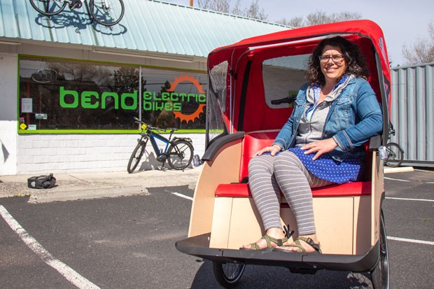Courtney sits in a trishaw, or bike taxi, that she recently purchased for the Bend chapter of Cycling Without Age. - KEELY DAMARA