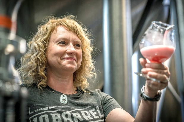 Brewmaster Tonya Cornett of 10 Barrel inspects one of her latest endeavors. - COURTESY 10 BARREL BREWING