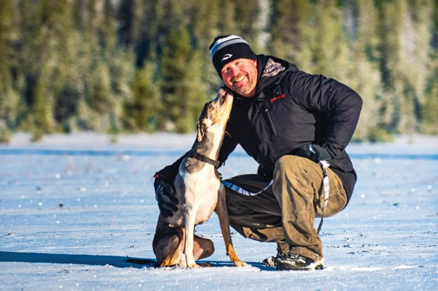 JD Platt and one of his dogs, Wallowa, during the photo shoot for Central Oregon Pets at Dutchman Flat. - DARRIS HURST