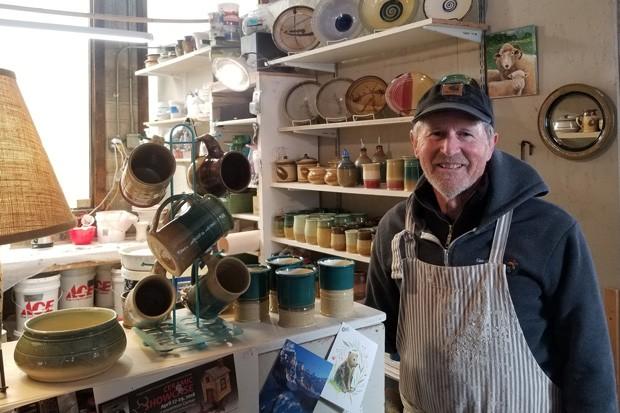 Studio member Mike Hoffman, maker of hand-thrown, functional stoneware, in his studio. - CARI BROWN