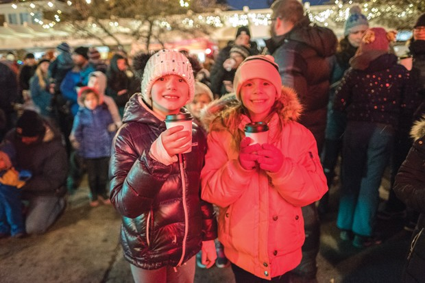 The community comes together in Drake Park for a traditional tree lighting ceremony Dec. 6. - PHOTO BY MIGUEL EDWARDS