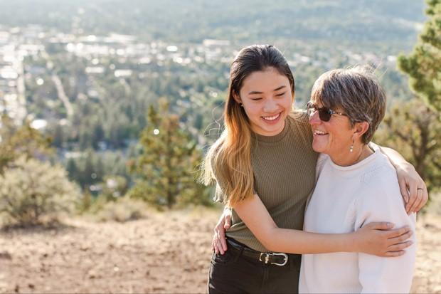 Emily Krehbiel shares a smile with Mom, Joanie. - NATALIE STEPHENSON