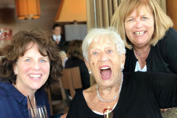 Gert Boyle, center, in typical exuberant fashion, poses with daughter Sally, left, and Kathy, right. - COURTESY KATHY DEGGENDORFER