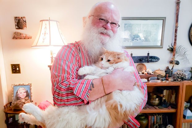 Mani Pureheart (Santa) poses with his own version of Rudolph (Ajax the cat). - CAYLA CLARK