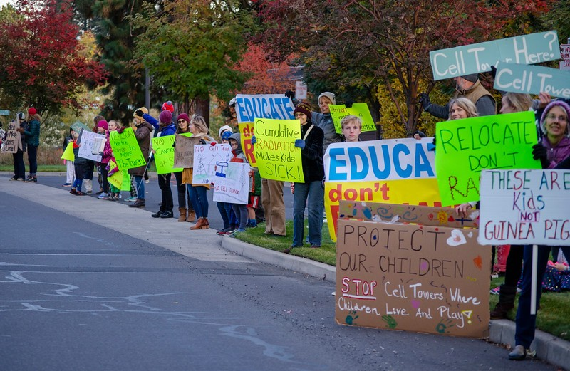 Parents and students from Elk Meadow Elementary School demonstrate outside of the Bend Parks & Recreation District office on Oct. 17, 2019 before a town hall meeting with representatives from Verizon Wireless. - BRIANNA PORTEOUS