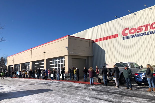 Shoppers line up outside the Bend Costco Tuesday morning to stock up. Household supplies such as toilet paper remain in short supply on store shelves around Central Oregon. On Monday, Gov. Kate Brown reminded Oregonians to avoid hoarding supplies and to buy only what households need in order to maintain a two-week emergency supply stock at home. - NICOLE VULCAN