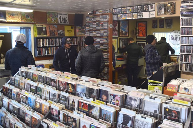 Music listeners and collectors arrive early as possible to Recycle Music on Record Store Day 2019. - ISAAC BIEHL