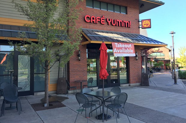 Café Yumm in the Old Mill District has closed down all indoor table service, but customers are welcome to sit outside on the patio. Owner Karli Foster has spaced the tables 10 feet apart for social distancing. - DARRIS HURST