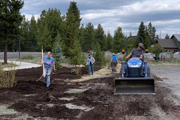 Volunteers work to create a new Victory Garden near the La Pine Senior Center. - COURTESY SOUTH COUNTY GARDEN