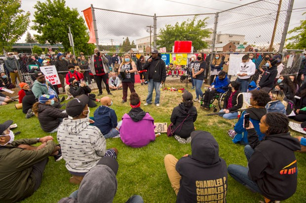 Waites speaks at the Black Lives Matter vigil Saturday at Troy Field in downtown Bend. - DARRIS HURST