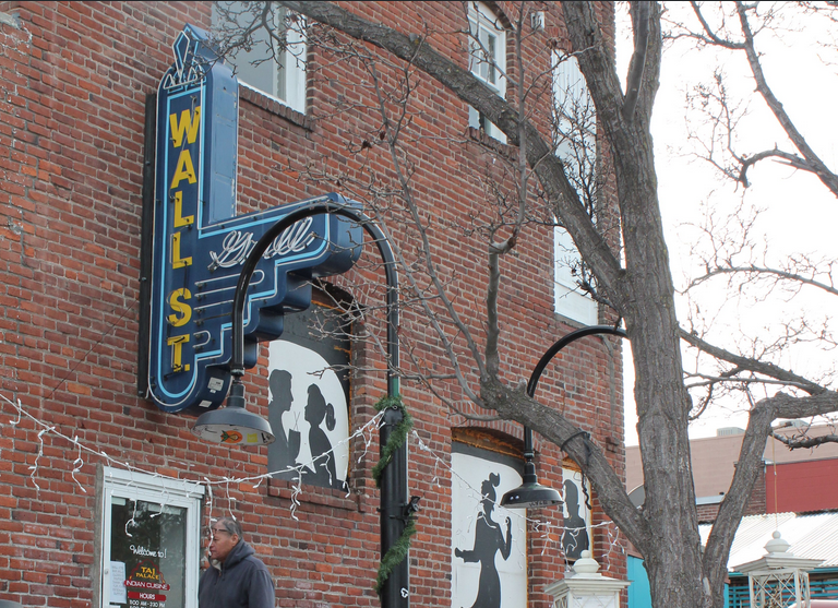The deck off of Wall Street Bar on NW Brooks Street is a favorite hotspot of longtime locals and tourists in the know. The OLCC reported the bar twice to OSHA because its customers weren't wearing masks on the deck. The second time, the report came three days before the governor's order for masks outdoors was in effect. - FILE PHOTO / LAUREL BRAUNS