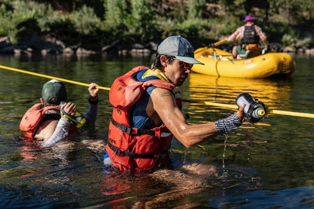 """Mario Mendoza, Jr. undergoes a river crossing during the 100 mile, """"Western States 100"""" race. The race which starts in Squaw Valley and ends in Auburn Oregon, took Mario a mere 18 hours, 33 minutes, 11 seconds to finish - PAUL NELSON"""