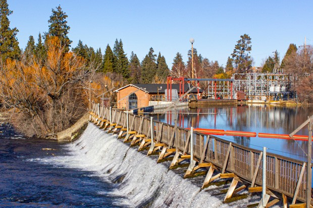 The Newport Avenue dam was first built in 1909, creating Mirror Pond. At the time, it provided an abundant source of power for the small town of Bend. Today it provides enough power for less than 1,000 Bend homes. - DARRIS HURST