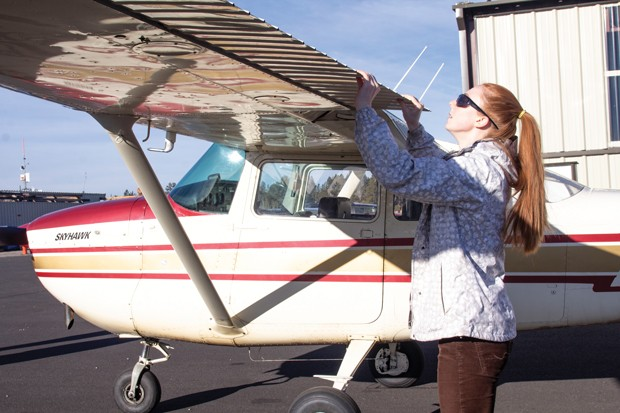 Outlaw Aviation student pilot Mary Root completing a pre-flight inspection of her Cessna 120 tailwheel light aircraft. - KYLE SWITZER