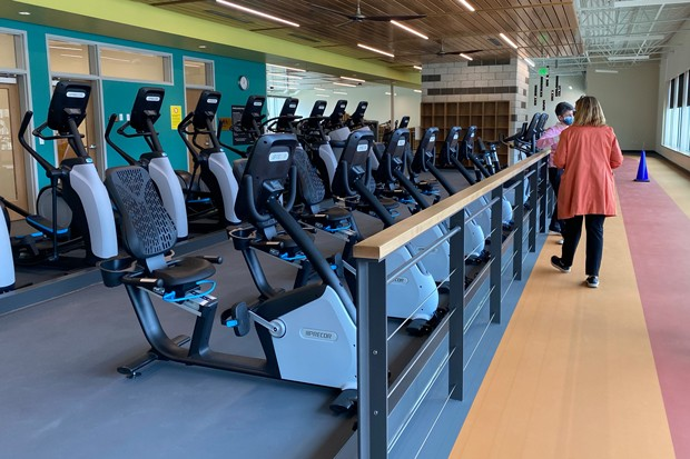 The fitness center includes an indoor walking/jogging track, as well as fitness equipment users can sync with an app to track fitness data. - NICOLE VULCAN