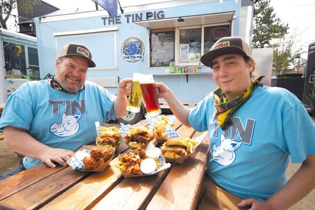 Jack Tate, left, and Matthew Gutierrez raise a toast to the almighty chicken. - DARRIS HURST