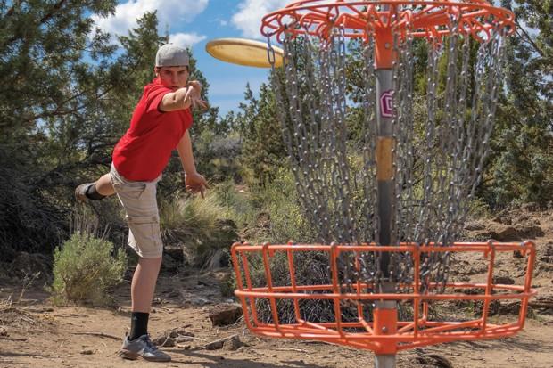 Xander Hurst focuses on the putt at Pine Nursery Park. - DARRIS HURST