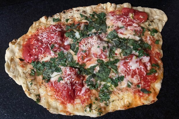 Grilled pizza: another reason to cook outdoors. - ARI LEVAUX