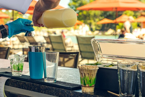 A full bar poolside is part of the experience at the newly renovated aquatic center. - COURTESY SUNRIVER RESORT