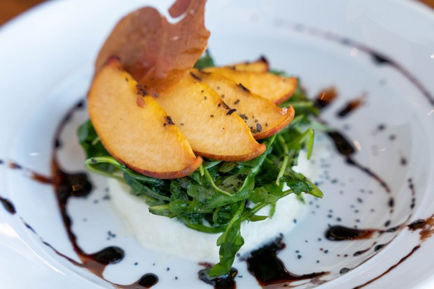 Grilled Peach Burrata, a summer favorite on the Solomon's at Tetherow menu. - MIKE WEST