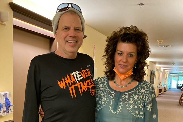 """Jeff Rasmussen with his physical therapist, Amy Musgrave. Rasmussen's """"Whatever it takes"""" shirt came from Musgrave's son, an Oregon State University football player, who was inspired by Rasmussen's story. - COURTESY JEFF RASMUSSEN"""