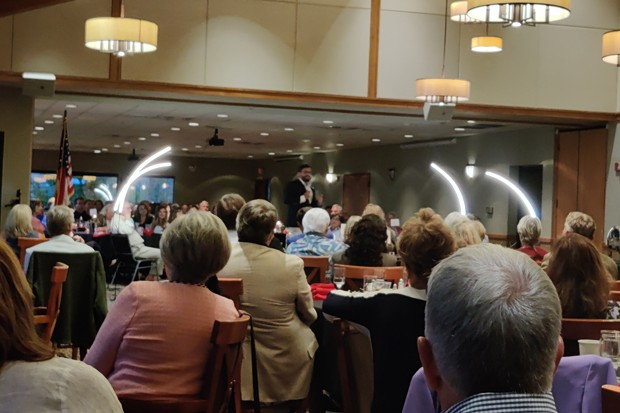 National Pulse Editor in Chief Raheem Kassam stands center stage in Bend Golf Club's dining hall on Wednesday, Aug. 25, for a sold-out fundraiser. - JACK HARVEL