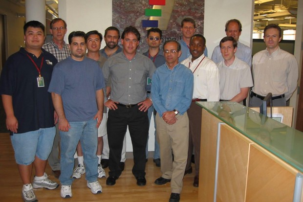 Chuck Allen stands with coworkers years after many of them survived the September 11 attacks. - COURTESY OF CHUCK ALLEN.