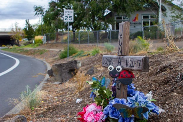 A memorial for Jonathan Adams, who was struck and killed by a Fed-Ex semi-tractor trailer in the intersection just east of NW Wall Street as the vehicle was turning right from NW Wall Street onto NW Olney Avenue on Nov. 20, 2017. - ELLA TAFT