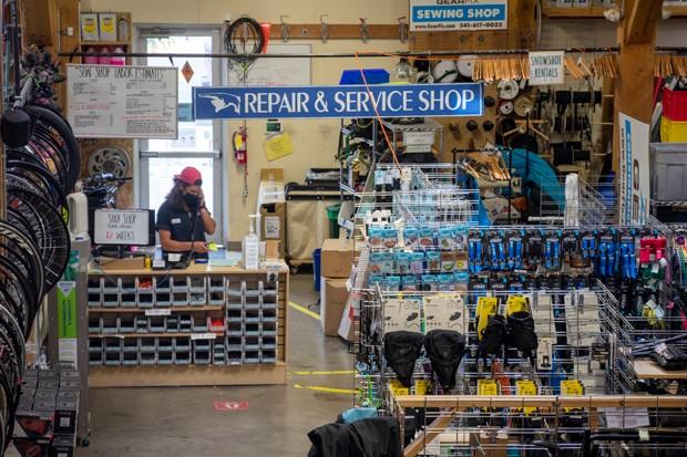 Nico Brilmyer works the repair station at Gear Fix in Bend. - TREVOR BRADFORD