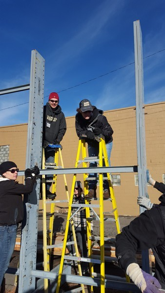 Some of the Deschutes Brewery team volunteered for the Bend Area Habitat by moving a large lumber rack at the ReStore.