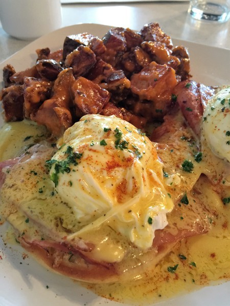 Traditional eggs benedict and large windows make even a snowy day in Bend bright.