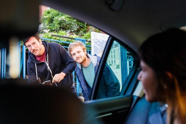 Millennials hailing a cab. JK—millennials don't use app-less technology. - UBER.COM