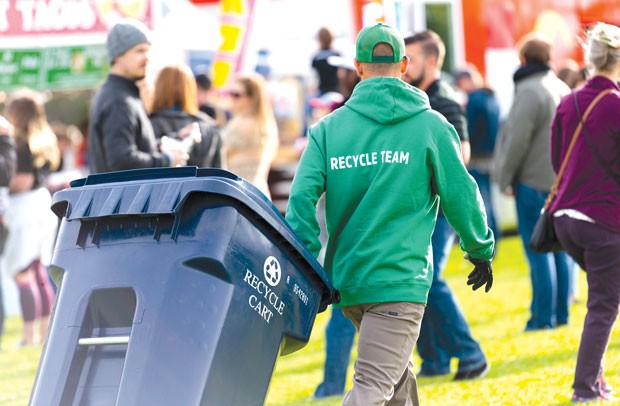 Venues including the Les Schwab Amphitheater and the Athletic Club of Bend use The Broomsmen to sort and dispose of recycling—one of a few steps the teams at local venues take in the name of sustainability. - TYLER ROWE
