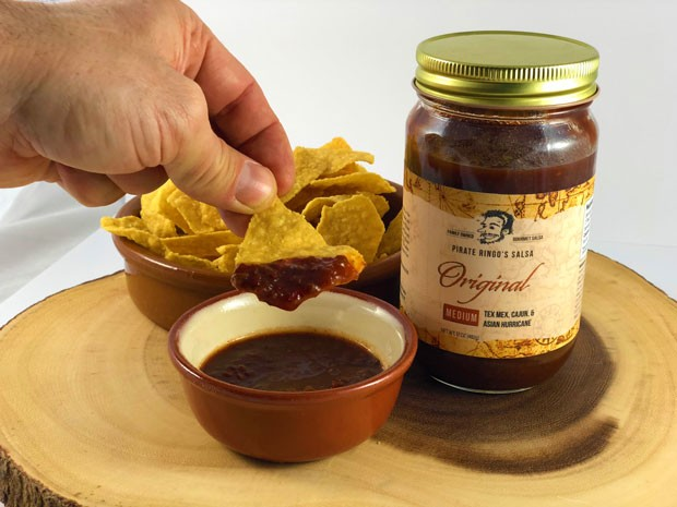 The illustrated face on the Pirate Ringo's Salsa label is Chris Ringo, which he drew himself. Through genealogical research he discovered there were pirates in his family. - LISA SIPE