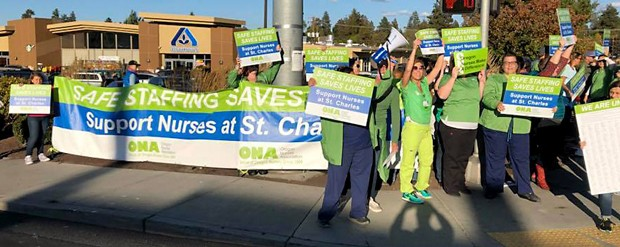 Local nurses call on St. Charles executives to reach a fair contract agreement that improves patient care and ensures safe staffing standards throughout the hospital during a rally in Sept. 2018. - OREGON NURSES ASSOCIATION