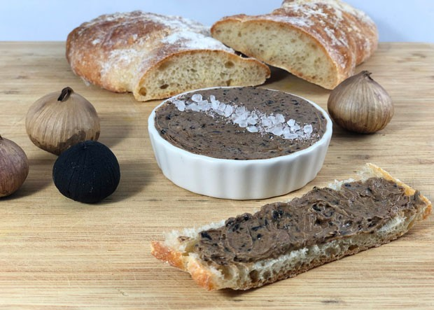 Salted butter and black garlic combine to make a tempting spread for fresh bread or added to roasted, baked or mashed potatoes. - LISA SIPE