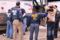 "ICE agents with some of the suspects arrested in operation ""Night Moves."""