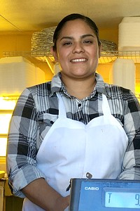 Isabel Castillo smiles from her taco truck, El Amigazo, located on Highway 97 opposite Safeway in Redmond. Her family members work at least 11 hours a day to make their new business thrive.