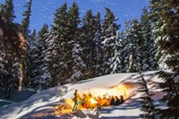 Tour-goers take a break from snowshoeing to admire the vast beauty around them.