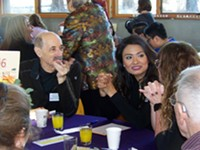 Volunteers and supporters eat, talk, and contribute at the Latino Community Association's 2018 Empowering Families Luncheon.