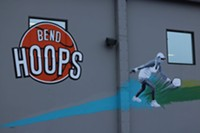 Eye-catching murals on the Bend Hoops building.
